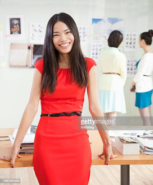Smiling Businesswoman in Creative Office