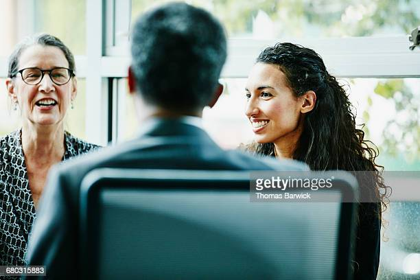 Smiling businesswoman in discussion during meeting
