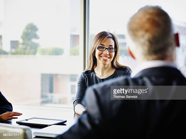 Smiling businesswoman in discussion in meeting