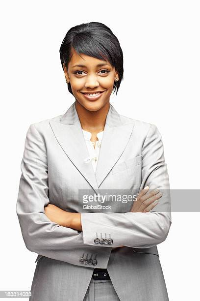 Smiling businesswoman in gray suit with arms crossed