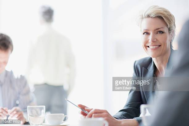 smiling businesswoman in meeting - juror law stock pictures, royalty-free photos & images