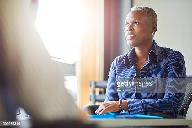 smiling businesswoman in meeting - androgynous stock pictures, royalty-free photos & images