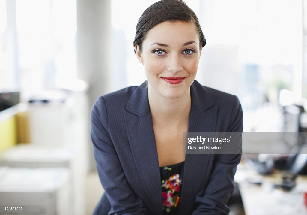 Smiling businesswoman in office : Stock Photo