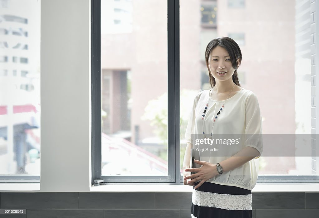 Smiling businesswoman in office : ストックフォト