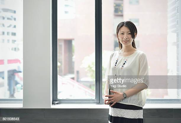 smiling businesswoman in office - blouse ストックフォトと画像
