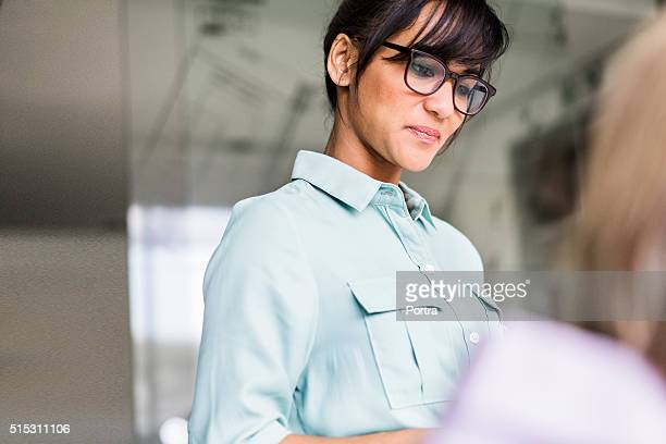 smiling businesswoman in office - 30 39 years stock photos and pictures