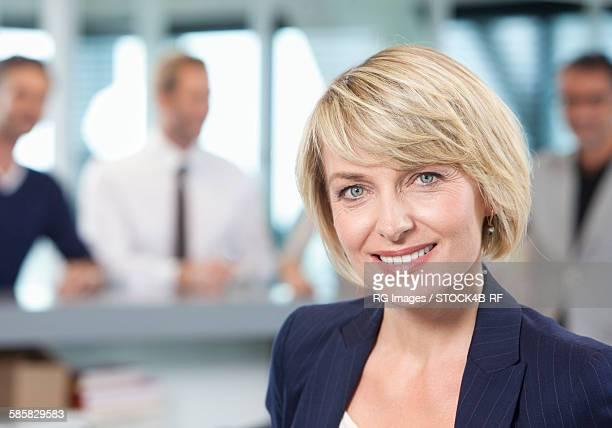 Smiling businesswoman in office, portrait