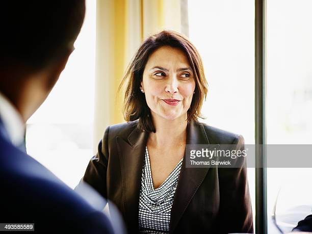 Smiling businesswoman in restaurant during meeting
