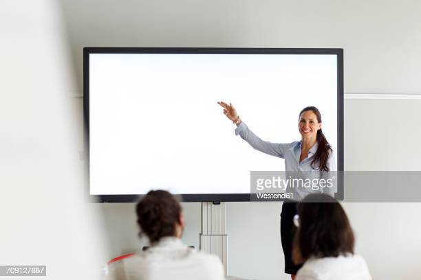 Smiling businesswoman leading a presentation