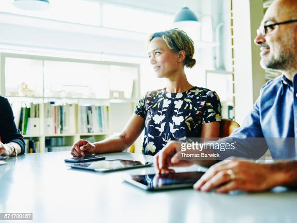 Smiling businesswoman listening during meeting