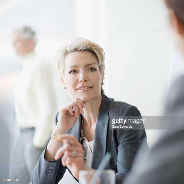 Smiling businesswoman listening