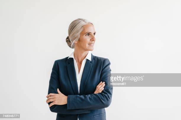 Smiling businesswoman looking sideways