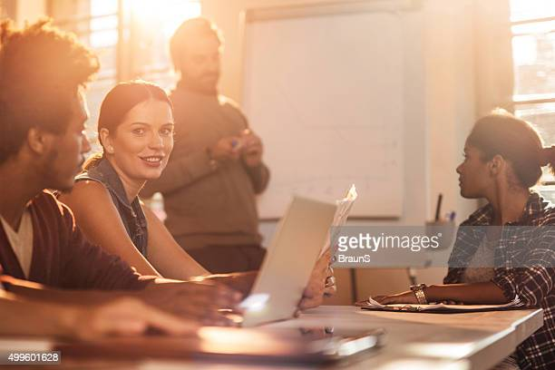 Smiling businesswoman on a business presentation in the office.
