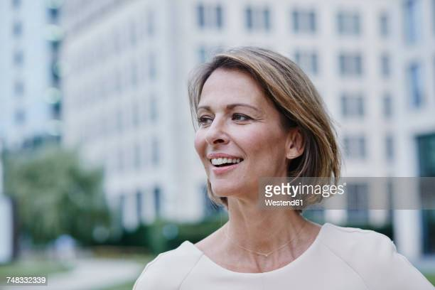Smiling businesswoman outdoors