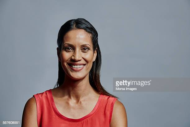 Smiling businesswoman over gray background