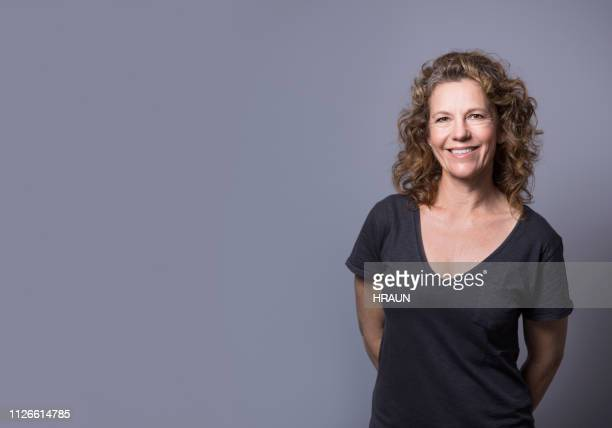 smiling businesswoman standing by copy space - retrato formal imagens e fotografias de stock