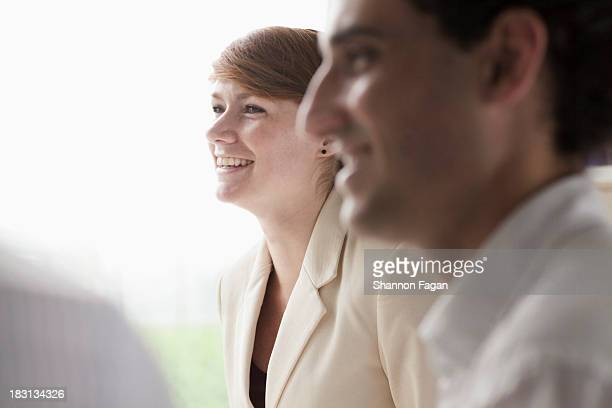 Smiling businesswoman talking to her colleagues