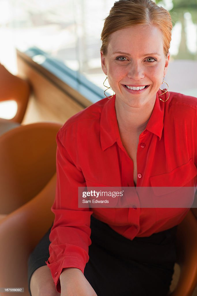 Smiling businesswoman using cell phone : Stock Photo