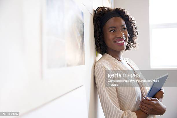 Smiling businesswoman using digital laptop in offi