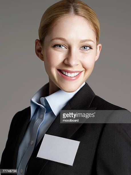 Smiling Businesswoman Wearing Blank Nametag