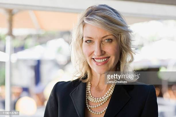 Smiling businesswoman wearing pearls