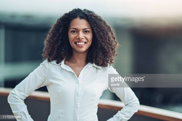 smiling businesswoman wearing white shirt - white shirt stock pictures, royalty-free photos & images
