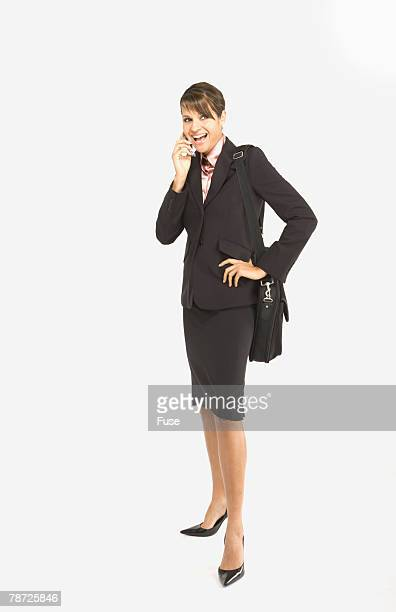 Smiling Businesswoman with Cell Phone and Shoulder Bag