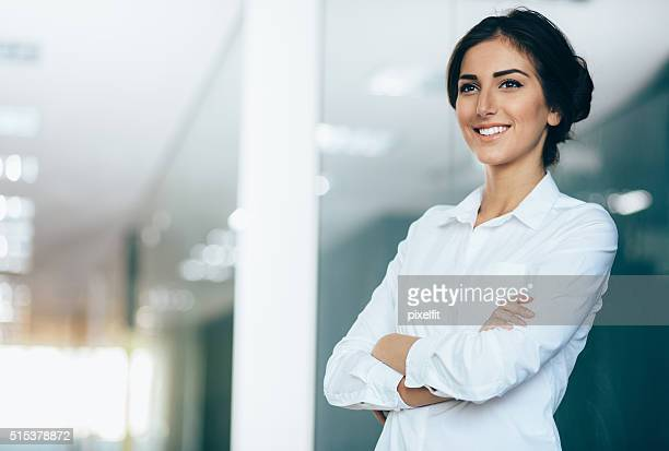 Smiling businesswoman, with copy space