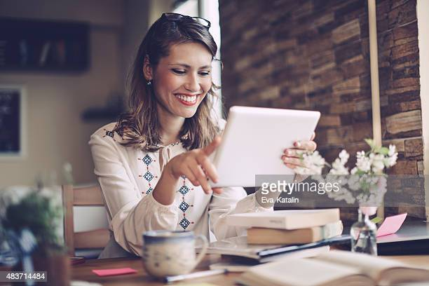 Smiling businesswoman woman working at home