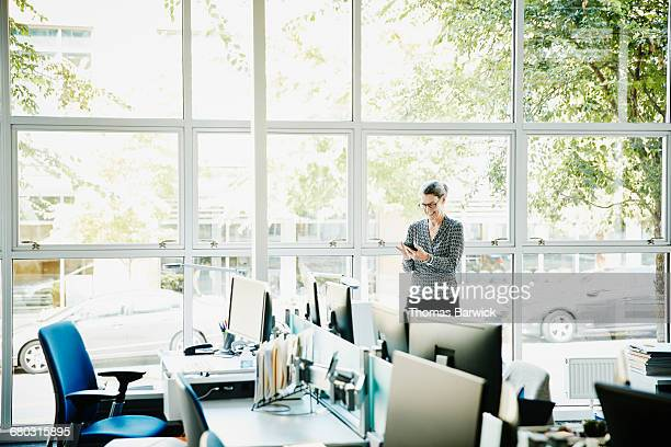 Smiling businesswoman working on smartphone