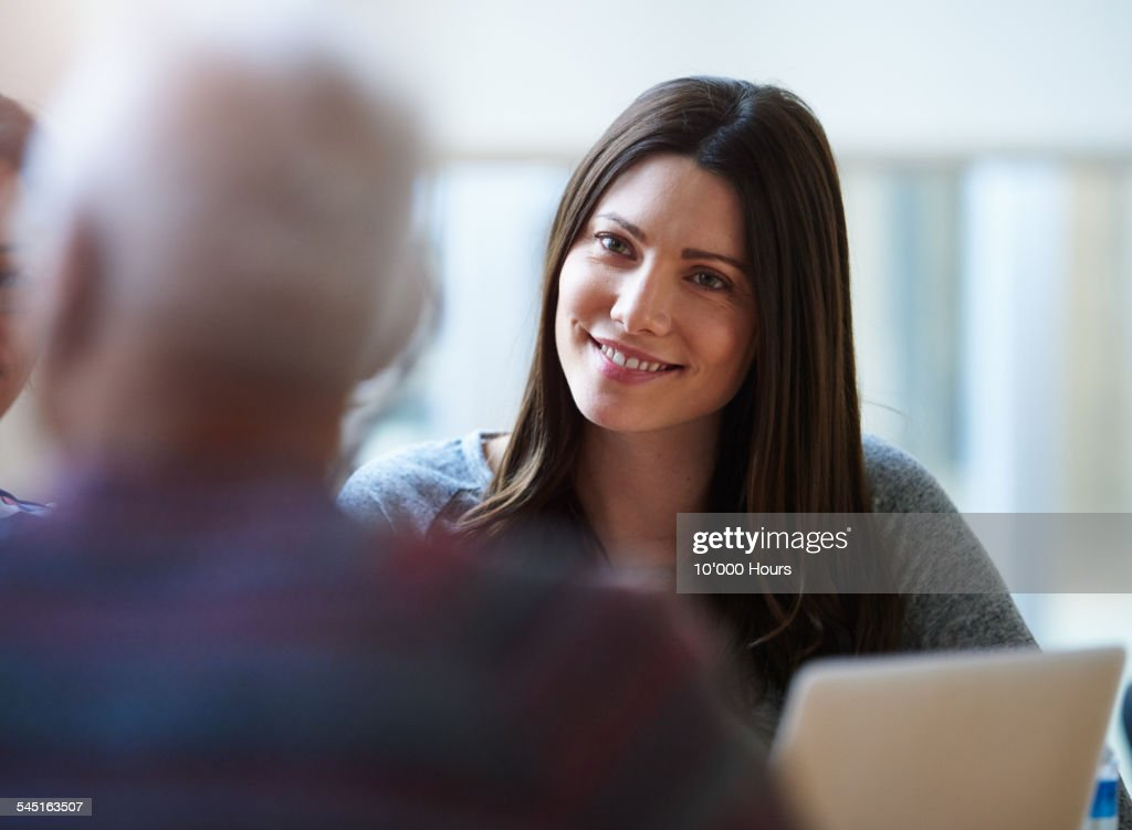 Smiling businesswomen discussing a project : Stock Photo