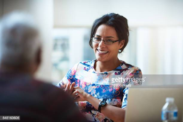 Smiling businesswomen discussing a project