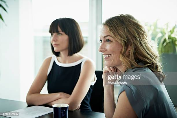 Smiling businesswomen in meeting