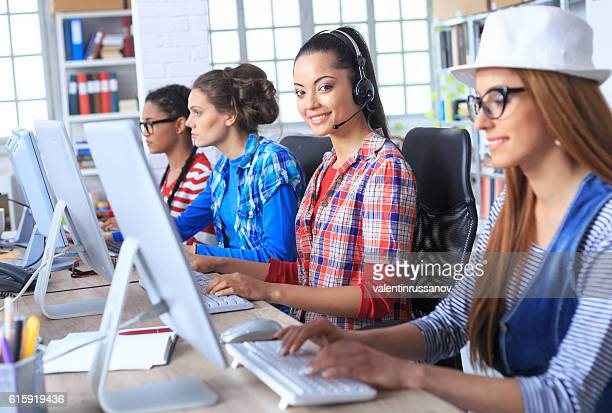 Smiling call centre team at workplace