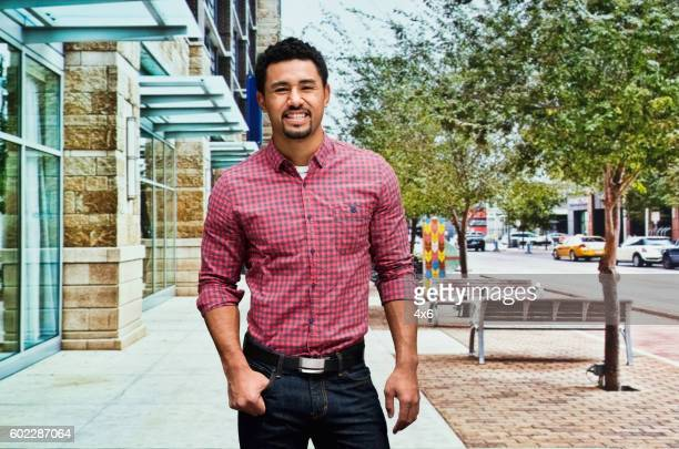 Smiling casual man outdoors in the city