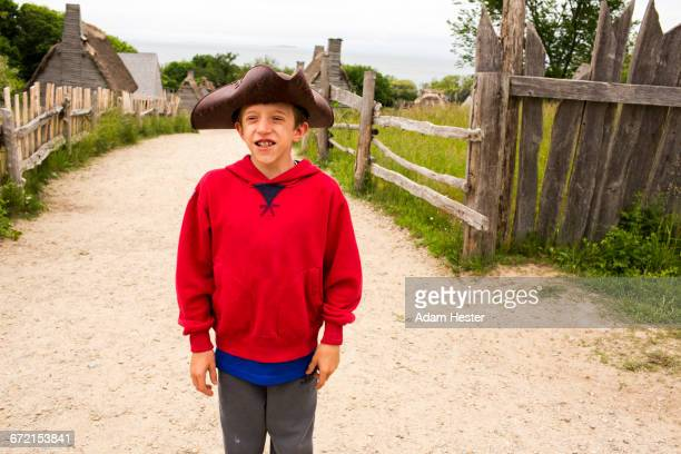 smiling caucasian boy posing in tricorn hat on dirt path - plymouth massachusetts stock photos and pictures