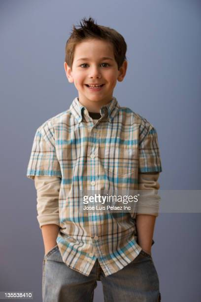 Smiling Caucasian boy with hands in pockets