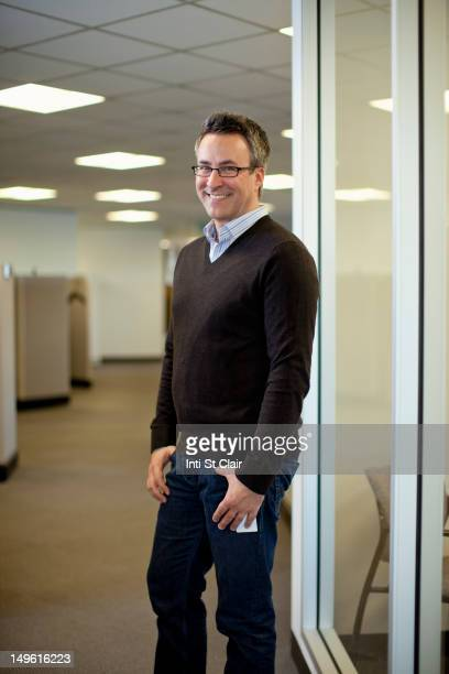 Smiling Caucasian businessman standing in office