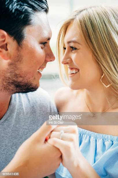 Smiling Caucasian couple holding hands