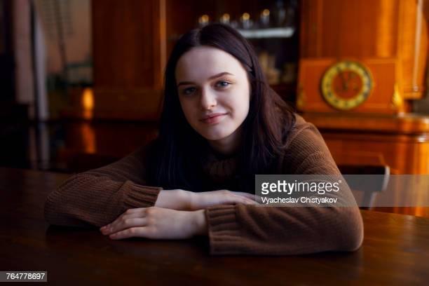 Smiling Caucasian girl sitting at table