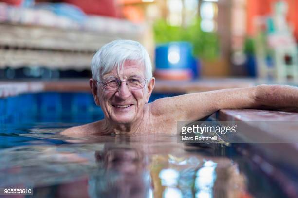 Smiling Caucasian man in swimming pool