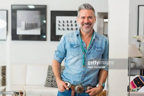 Smiling Caucasian man leaning on pillar