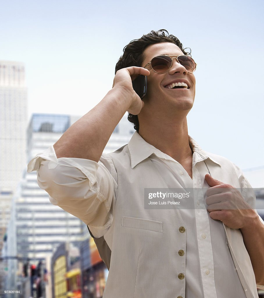 Smiling Caucasian man on the phone : Stock Photo