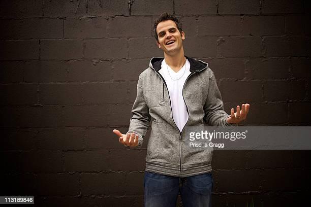 Smiling Caucasian man shrugging