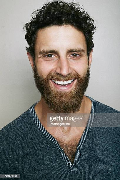 Smiling Caucasian man with beard looking at camera