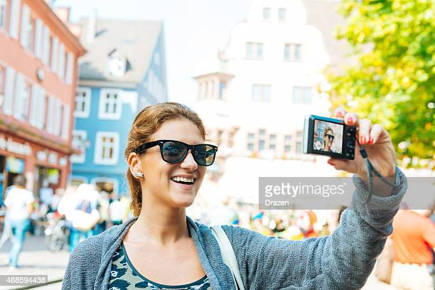 smiling caucasian traveller taking selfie - drazen stock pictures, royalty-free photos & images