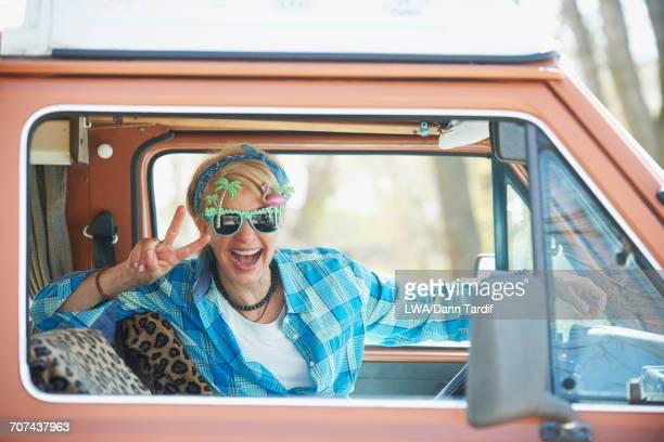 Smiling Caucasian woman driving camper van