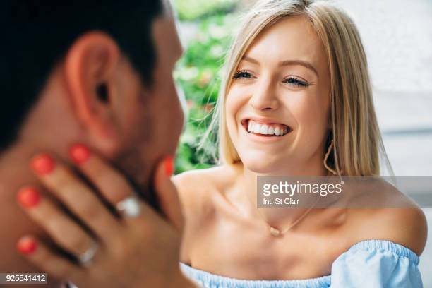Smiling Caucasian woman embracing man