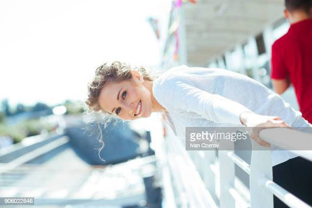 smiling caucasian woman leaning over railing - adults only photos stock pictures, royalty-free photos & images