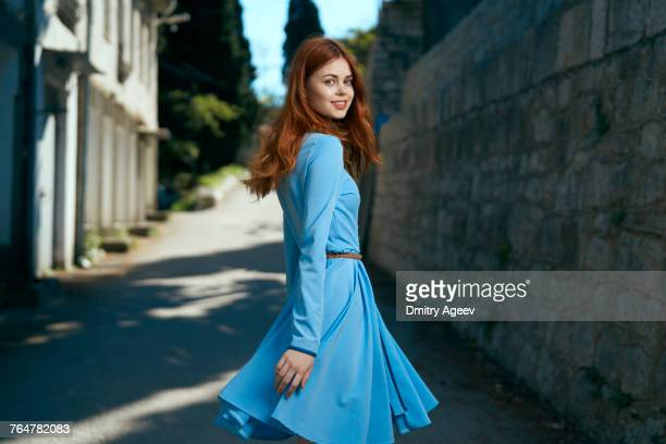smiling caucasian woman near stone wall - dress stock pictures, royalty-free photos & images